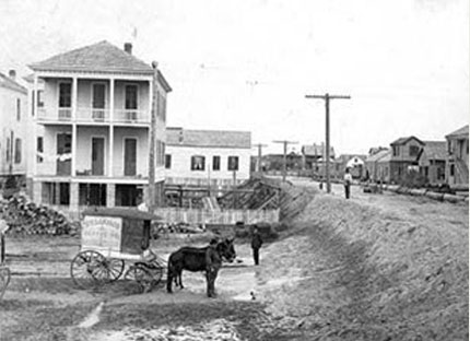historic photo of building of galveston seawall
